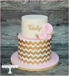 Gold and pink baby shower caje
