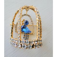 Brooch Bird Domed Cage Swinging Blue Bird Crystal Sparkling Pin ($45) ❤ liked on Polyvore