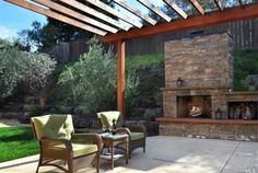 Outdoor fireplace/patio area = dream come true.   One day :)