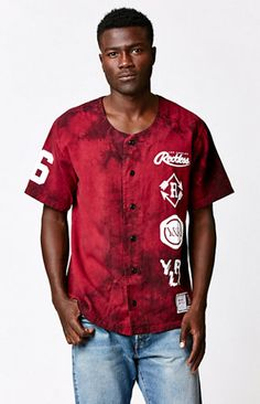You'll hit a home run every time as long as you're sporting the Home Plate Jersey by Young & Reckless. This baseball inspired button up shirt features short sleeves, an allover tie-dye design, and bold, Young & Reckless graphics on the right sleeve and throughout the front and back.   Tie-dye buttondown baseball jersey Young & Reckless graphics throughout Crew neck Short sleeves Machine washable