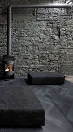 = industrial stone wall and parquet floor