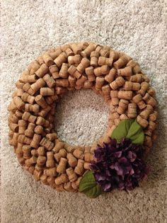 These custom wreaths are made from champagne corks that I have collected from restaurants. The pictures are an example of what the wreath will look like. Wreaths can be left plain for you to decorate, or I can affix fake flowers (as shown) to it. As these are made to order, please allow one week from ordering to ship.  The finished wreath measures approximately 22 wide and includes twine to hang from a wreath holder. Because it is made of several hundred corks, it is heavy. This should be…