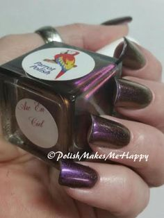 """Loving another Parrot Polish manicure! Showing here is a retired color, that I was lucky enough to purchase a bottle! A wonderful color-shifter, this is """"Arc En Ciel"""". Changing from purple to copper and a few shades in between. My mani is three thin coats. A great formula! Thank you Parrot Polish for this polish! I simply LOVE IT!!! heart emoticon #nails #notd #prettynails #nailswag #indie #supportindies"""
