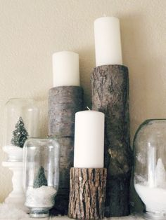 Logs used as candle holders & Waterless snow globes.  i love the idea of a woodland christmas look!