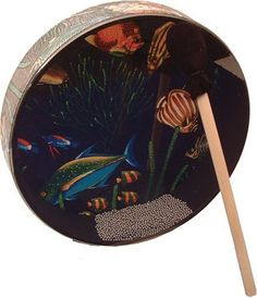 """Remo 12"""" Ocean Drum, Fish Design Head by Remo. $49.48. Pretend you are at the beach with an ocean drum, as you recreate the sound of the crashing waves of the sea. This unique two-headed drum has a clear head on one side and a head printed with a fun fish design on the other, with steel shot inside and a rough-finish Remlar-covered shell. Create wonderful sound effects simply by shaking or tilting the drum, or play rhythms with the included mallet. (Remember, since the drumh..."""