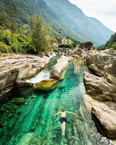 sixpenceee: Swimming in the crystal green waters, Lavertezzo, Switzerland. Via reddit user art0on