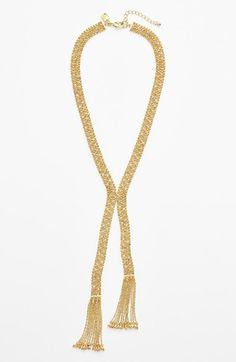 Dressing up a basic tee with this pavé mesh necklace.