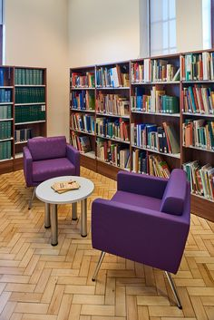 Modern chairs and restored parquet flooring look cool together