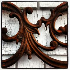 Beautiful detail of a salvaged rusty cast iron panel from New Orleans.  Photo by Old House Chic.