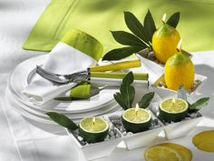 Love this simple summer table setting, especially the lime candles! #entertaining