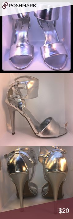 Charlotte Russe size 8 sexy💋silver boots Charlotte Russe(size 8)sexy silver heels with 4 inch heels!! This shoes are in perfect condition EXCEPT on the tip toe area, there are a few scuffs on each shoe, see picture #7 & #8; when wearing the shoe, these scuffs are hard to see!! The rest of the shoe looks awesome! Worn once!! From a non-smoking home! Charlotte Russe Shoes Heels