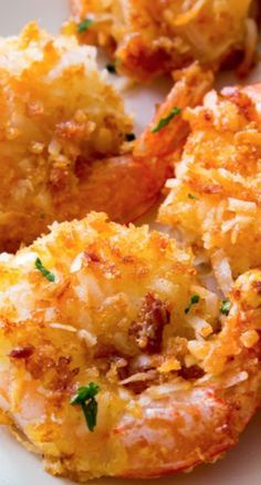 Easy Coconut Shrimp...double up on coconut by double dunking in egg and coconut. Nix the flour. Sptay shrimp...Bake on parchment at 350 until golden..flipping half way through.