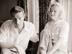 Joe Dimaggio & Marilyn Monroe.......love the way she's looking at him
