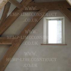 Lime plaster onto hempcrete walls with oak frame
