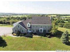Colonial - Watertown-Town, NY Outstanding location, outstanding views, outstanding construction!  Words barely describe the sense of awesomeness you have driving the winding tree lined drive into this custom built limestone home.  Incredible scenic view of city and lake and wonderful sense of privacy.  This light filled home has large kitchen, eating area, island and attached family room w gas FP.  Formal dining and living spaces as well as main flr office.  Large bedrooms each with…