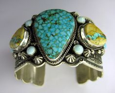 Cuff | Guy Hoskie.  Sterling silver, Kingman turquoise stone, two Boulder turquoise stone and six Sleeping Beauty stones
