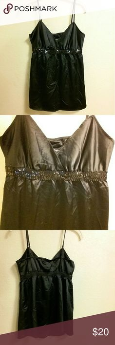 FLASH SALE! NWT Express Black Sequin Top New with tags Black Express Top with Sequin detailing. 96% polyester 4% spandex Express Tops Blouses