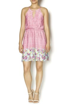 """Pink printed halter neck dress with a faux wrap front that features a keyhole front. This dress has a A-line fit, elasticized waist and an exposed back zipper. Approximately 36"""" long. For a more put together outfit throw a white cropped blazer over this dress."""