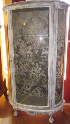 painted and stenciled curio cabinet