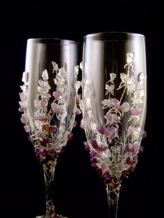 pretty purple, maroon and lavendar stones decorate champagne wedding flutes. I really like these but they don't go with my color scheme ::pouts:: Bride And Groom Glasses, Wedding Wine Glasses, Wedding Champagne Flutes, Champagne Glasses, Bride Groom, Decorated Wine Glasses, Painted Wine Glasses, Burgundy Wedding, Diy Wedding