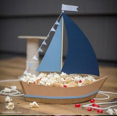 Ship Party Snacks with This DIY Paper Sailboat Centerpiece!- Ship Party Snacks with This DIY Paper Sailboat Centerpiece! Need a nautical centerpiece for your kid& party? We& come up with an amazing, easy-breezy paper sailboat snack holder project. Nautical Centerpiece, Party Centerpieces, Cardboard Crafts, Paper Crafts, Cardboard Furniture, Diy For Kids, Crafts For Kids, Boat Crafts, Ostern Party
