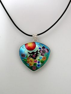 Cloisonne enamel and silver necklace with a cat peeking out of the garden - Leona in the Garden by Zenamels