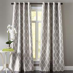 The geometric patterns in Pier 1's Moorish Tile Curtains make this window seem a bit larger.
