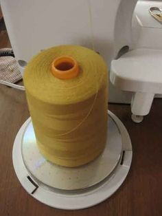 A great DIY trick to create your own thread holder to use cones with your machine - genius!!
