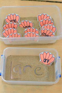 Write words in sand - we dig real shells out of a bucket of sand for graphing and this would be a great LA activity to add to our beach theme!