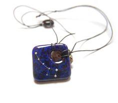Phosphorescent Little Dipper on deep blue marble
