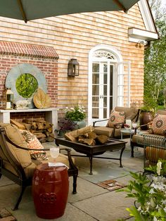 A cozy fire pit creates a great place for entertaining and relaxing. More patio ideas: http://www.bhg.com/home-improvement/exteriors/curb-appeal/curb-appeal-tips/?socsrc=bhgpin032513firepitpatio