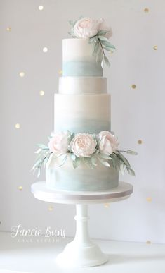 Cake Trends - 20 Metallic Wedding Cakes Dusky blue watercolour & silver lustre tiers, adorned with barely blush sugar flowers & loose foliage.Dusky blue watercolour & silver lustre tiers, adorned with barely blush sugar flowers & loose foliage. Pink Silver Weddings, Metallic Wedding Cakes, Blush Wedding Cakes, Wedding Cake Roses, Floral Wedding Cakes, Dusty Blue Weddings, Elegant Wedding Cakes, Beautiful Wedding Cakes, Wedding Cake Designs