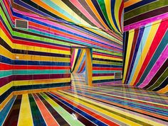 An impressive and colorful installation by the German artistMarkus Linnenbrink, who took overthe Kunsthalle Nuernberg center with a dripping rainbow created