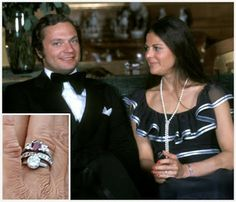 """Silvia Sommerlath's engagement ring is a simple ring, probably more like what many of us (particularly those most familiar with the American tradition) might expect from an e-ring. It's a single solitaire diamond, estimated by some to be in the neighborhood of two carats, and is said to have belonged to King Carl Gustaf's mother Princess Sibylla - she died a few years before the couple's engagement. Silvia now wears the ring with others on the same finger, including a ruby ring."""