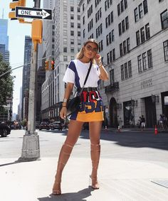 White printed Tee + patched mini  skirt + knee high sandal heels. Trendy fashion outfit idea / street wear.