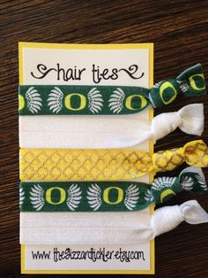 Tendance Bracelets  UO Oregon Ducks Elastic Hair Ties Set Perfect gift set for college students fans & DOUBLES as trendy bracelets march madness basketball  Tendance & idée Bracelets 2016/2017 Description UO Oregon Ducks élastique cheveux liens mis par TheGizzardTickler