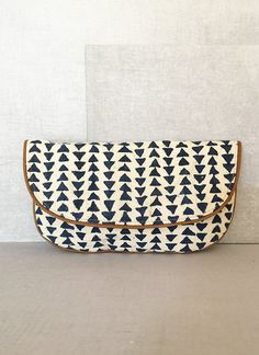 Piped Triangles Clutch - American Nomad || This perfectly simple and chic clutch is #handmade in Rajpur, India. This community is extremely poor and marginalized. Your purchase supports the artisans as they seek out respectable, viable work. It also supports the traditional techniques the artisans use to make this bag. #ConsciousConsumer #GlobalCitizen Find more at @philorgs.