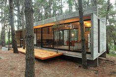 Prachtige combinatie van glas en beton. Zo woon je echt in je omgeving...