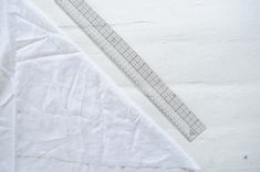 To create a custom bias trim, fold your fabric at a 45 degree angle, mark the desired width of your trim and cut. If this is completely new to you, stay tuned for a more detailed step-by-step on how to create and sew a bias trim. Diy Summer Clothes, Summer Diy, Diy Crop Top, Crop Tops, Sewing Clothes, Diy Clothes, Corset Sewing Pattern, Sewing Patterns, Matching Top And Shorts