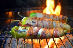 Bacon-Wrapped Cheese-Stuffed Peppers are anaheim peppers filled with cream cheese, wrapped in bacon and then grilled until crisp
