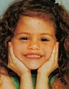 LOOK AT HER. She's adorable. How can you hate her?!