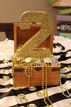 Glittery number at a Peter Pan Neverland birthday party! See more party ideas at…