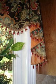 A flat valance & jabots with attractive fabric & trim.
