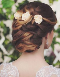 love the fresh flowers on this gorgeous updo wedding hairstyle; via Websalon Weddings