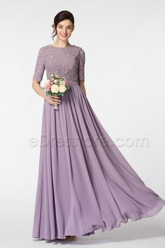 The Wisteria bridesmaid dress features O neckline and lace bodice, elbow length sleeves, fully lined and high back finish the modest look, A line skirt floor length.