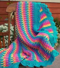 Sweet Tooth Rainbowghan - Bright and bold colors make up this sweet crochet baby blanket