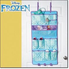 """Frozen Over-the-Door Organizer Talk about a cool storage solution! This 41"""" L x 20"""" W over-the-door organizer has 13 pockets and three accessories holders.  Shop 24/7, ship anywhere, happy shopping! ; ) http://jgoertzen.avonrepresentative.com/"""