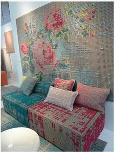 Look closely. The wall art is pegboard with cross stitching.