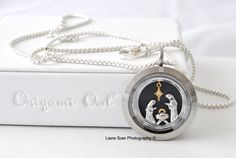 Origami Owl - For the Christmas season add a #Nativity window plate to your locket. Shown with the the #Prism twist locket face. Available at lianesoer.origamiowl.com