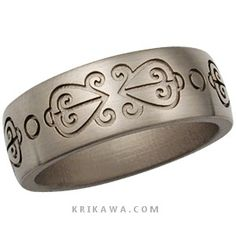 """""""Odo nnyew fie kwan""""--""""Love never loses its way home.""""  The design encircling this handsome wedding band is one of the many Adinkra symbols from West Africa.  What symbols do you want on your wedding ring? - This wedding band has a recessed symbol, the opposite of the main style image. The band is handcrafted out of white gold and has a brushed finish."""